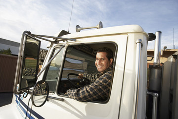 Man driving truck, close up