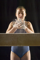 Gymnast 13-15 rubbing chalk into hands, portrait