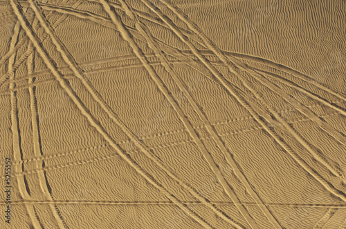 Tire tracks in sand, elevated view
