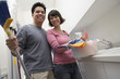 Couple doing housework, portrait