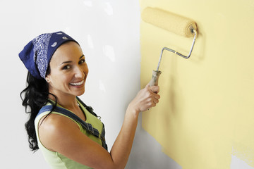 Woman Painting Room Yellow