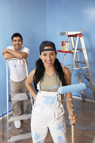 Couple in freshly painted room, portrait, elevated view