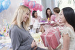 Woman giving gift at baby shower
