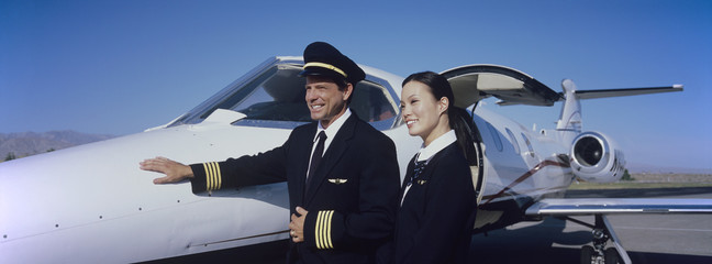 Members of Flight Crew Standing by Airplane