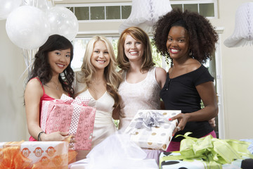 Friends standing Together with gifts at Bridal Shower