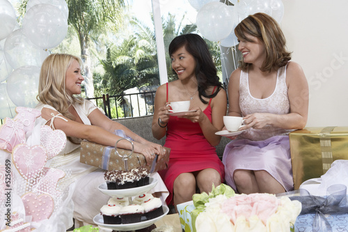 Bride talking to Friends, Giving Gifts at Bridal Shower