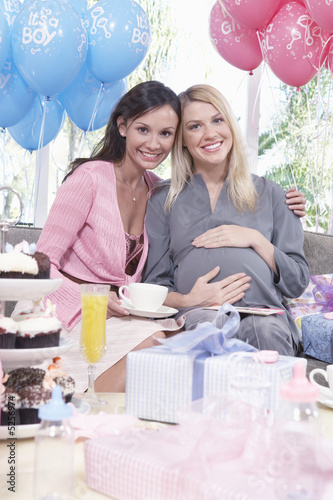 Women sitting on sofa at  baby shower
