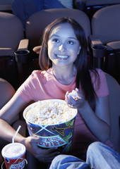 Woman Eating Popcorn in Movie Theater
