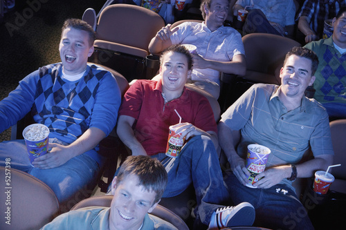 Friends Laughing at Movie