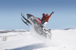 Couple Mid-air on Snowmobile