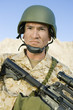 Soldier wearing helmet, outdoors, close-up, portrait