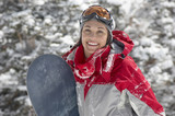 Young Woman with Snowboard in snow, half length