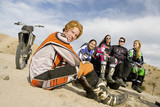 Motocross racers in desert, portrait