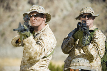 Armed soldiers standing side by side, outdoors