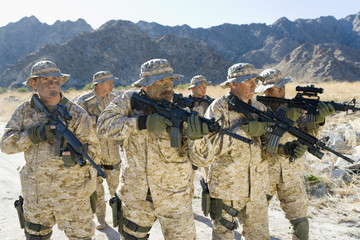 Military soldiers on patrol in mountains