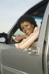 Young woman looking through car window