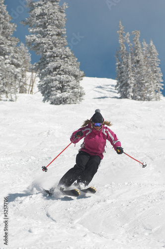 Teenage Girl Skiing Down a Slope