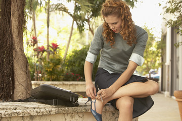 Woman Fixing Shoe