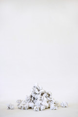 Pile of crumpled paper, on white background