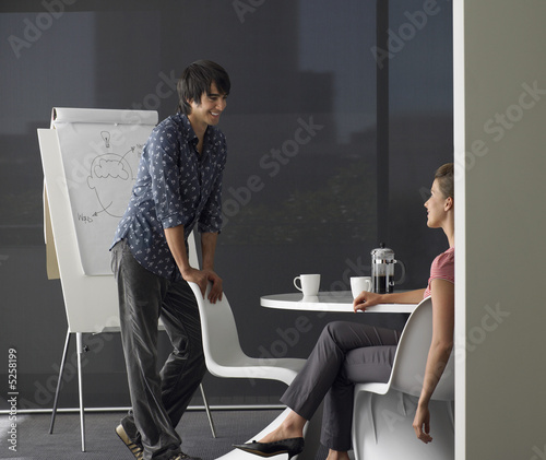 Business man giving presentation on flipchart
