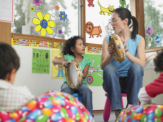 Teacher Demonstrating Tambourine Playing