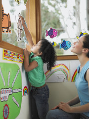 School Girl Decorating Window