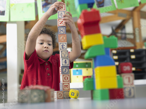Elementary Student Playing With Building Blocks
