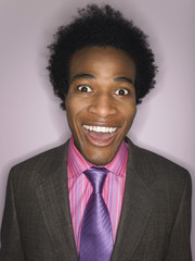 Man in suit smiling head and shoulders in studio