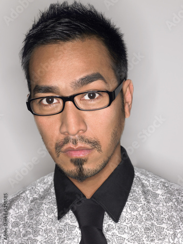 Man Wearing Glasses in studio portrait head and shoulders