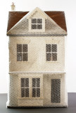 Model of house wrapped in bubble wrap
