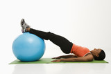 Woman exercising with ball. poster