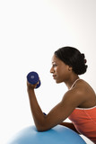 Profile woman lifting dumbbell. poster