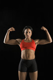 Woman athlete flexing muscles. poster