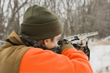 Man aiming shotgun.