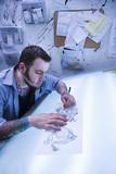 Man creating tattoo. poster