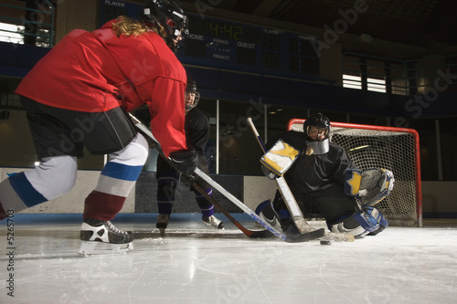 Women playing hockey.