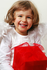 laughing angel with gift