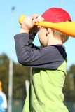 Child swinging baseball bat..