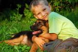 Boy hugging his dog - Fine Art prints
