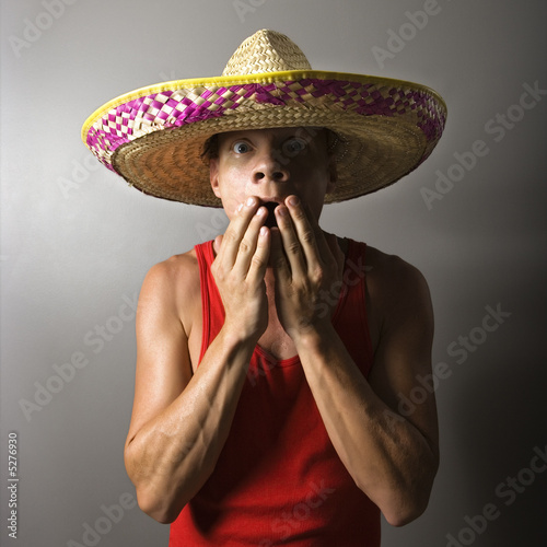 Man covering mouth.