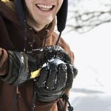 Teenager making snowball. poster
