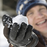 Teenager holding a snowball. poster
