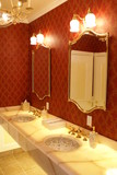 A newly renovated bathroom with sinks and mirrors. poster