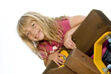 Little Girl Climbing a Playset