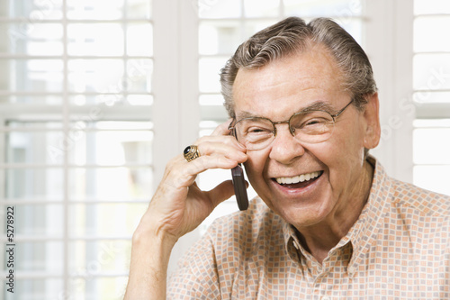 Mature man on cellphone.