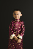 Asian boy in traditional attire. poster