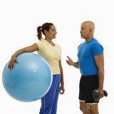Man and woman exercising. poster