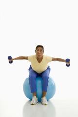 Woman exercising on ball.