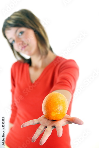 happy girl with orange in hand