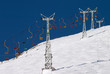 chair lift in blue sky